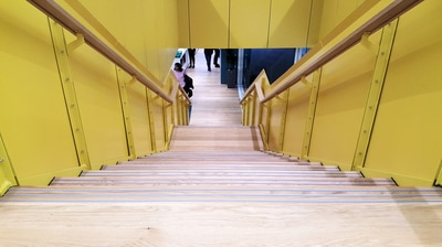 Freedom Strategies installed Stepmaster  stair inserts SMI501 Silver Anodised at Aurecon specified by Warren and Mahoney (WAM).