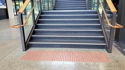 Carborundum stair nosing, and marron tactile ground surface indicator TGSI